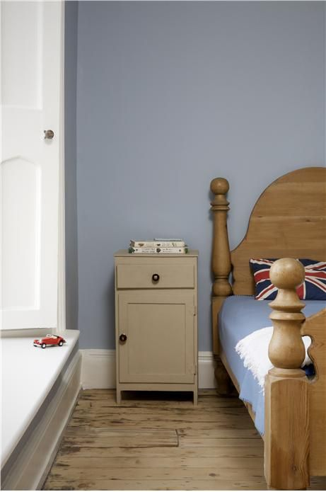 A bedroom with walls in Lulworth Blue Estate Emulsion and trim in Wimborne White Estate Eggshell. Cabinet in Joa's White Estate Eggshell.