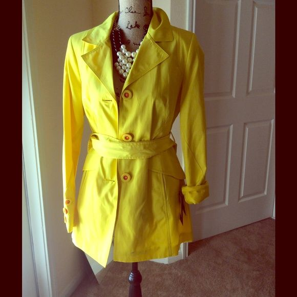 Black rivet yellow trench coat. Brand new. Never worn Wilsons Leather Jackets & Coats