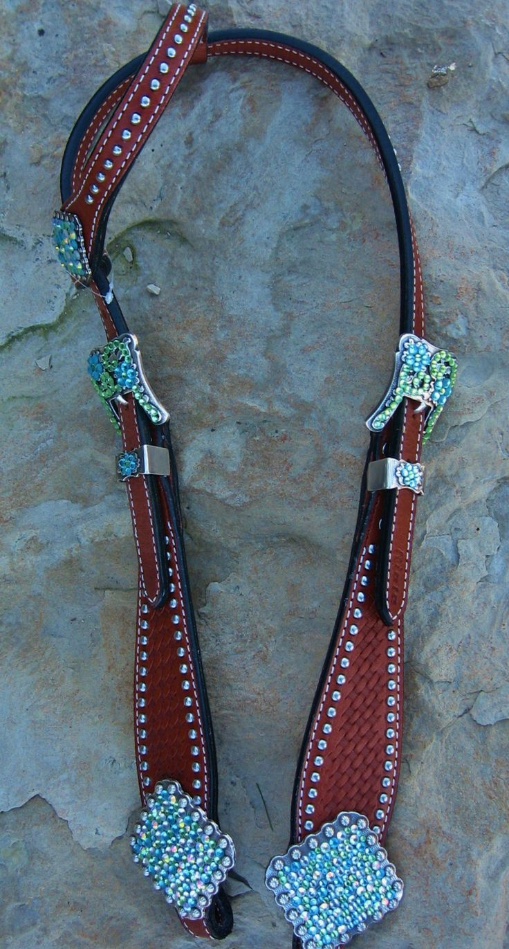 Custom designed headstall with confetti conchos in lime, turquoise, and ab clear glass crystals. Med, and dark oil available.