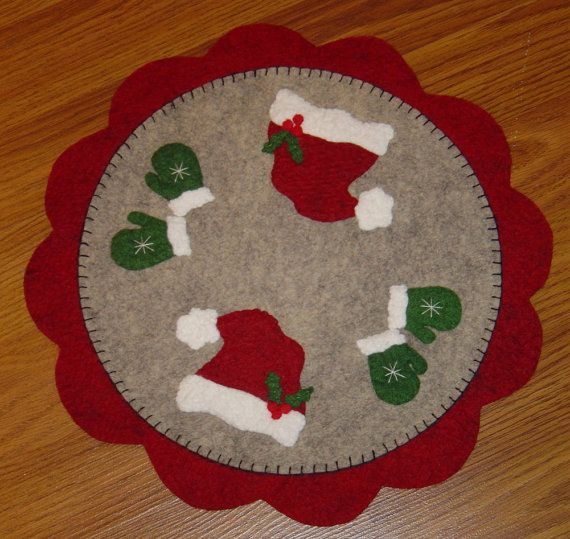 This fun candle mat/penny rug works up quick and easy. Make it with wool felt, felted wool or acrylic felt. Measures about 12 inches across.
