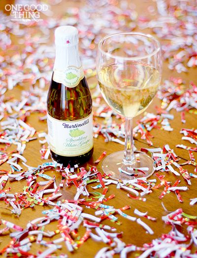 Shred your leftover wrapping paper into festive confetti for your New Year's Eve party decor!