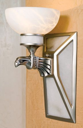 Eagle sconces light the foyer area in full Art Deco fashion. Their design is based on those gracing the exterior of New York City's Chrysler building. #crescentsupply #housetrends