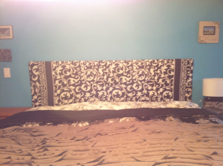 Homemade and super cheap king sized headboard. Ply wood from Home Depot, batting from JoAnn Fabrics, and a shower curtain from Marshall's. Fabric stapler and some hot glue.