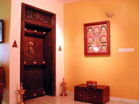 The triangular space on either sides for placing lamps. (This is usually the practice in south Indian villages.)""