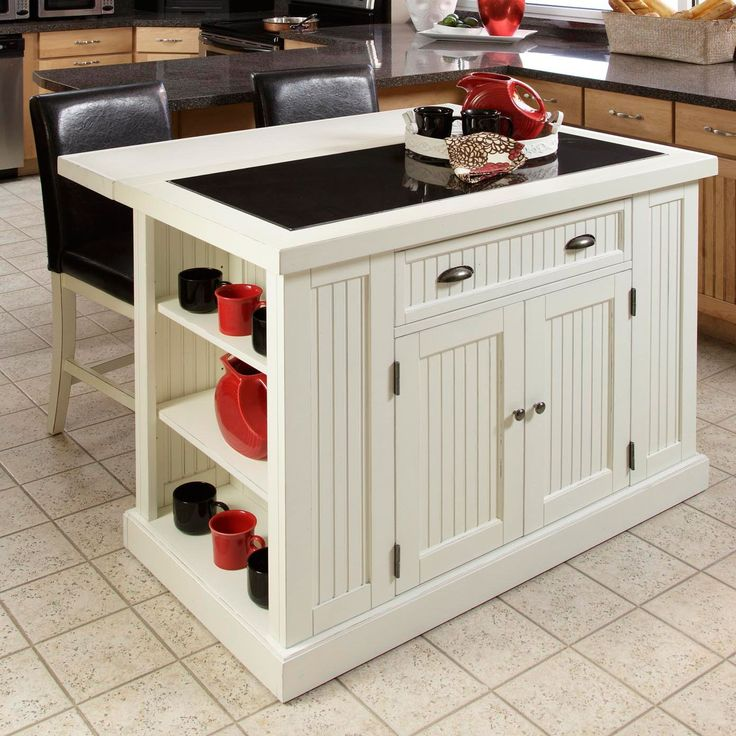 Add a chic touch to the heart of your home with this Nantucket distressed white kitchen island. It features ample storage space, including adjustable shelves, a drawer, and cabinets, so there's room for all of your culinary accessories.