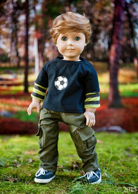 Inspired by American Boy dolls, here is a classic combo. The cargo pants have six working pockets for plenty of cargo, and the long sleeve tee has the layered soccer look. They are handmade and adapted from fabulous Liberty Jane patterns. They will fit American Girl/Boy dolls and many other 18 inch dolls. The cargo pants have a roomier, straighter fit in the hips and legs than the more feminine pants that I make. They are made of olive twill and feature: 6 real pockets (4 with velcro cl...
