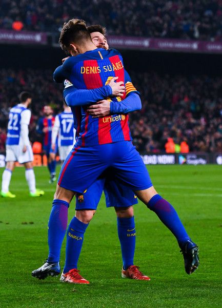 Denis Suarez of FC Barcelona celebrates with his team mate Lionel Messi after scoring his team's fifth goal during the Copa del Rey quarter-final second leg match between FC Barcelona and Real Sociedad at Camp Nou on January 26, 2017 in Barcelona, Catalonia.