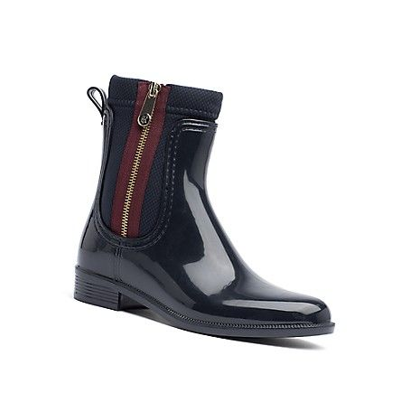 Tommy Hilfiger women's boot. These glossy stormy-weather essentials have us all…