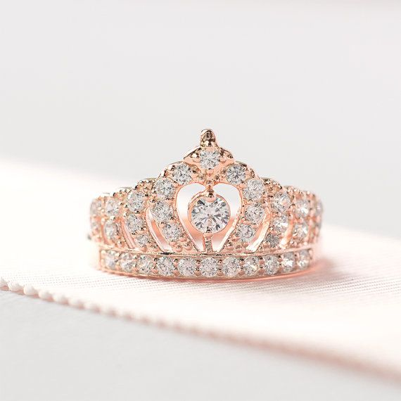 This tiara Ring is carefully crafted with fine details. This sophisticated design is characterized with a crown measures about 12mm tall, a 3.5mm centerstone and plenty of small brilliant stones. We made our ring with the highest quality of cz stone that is accessible to us, they sparkles amazingly, reflect light in the most glorious way. Made of 925sterling silver and is specially plated for tarnish resistance. Please note that this ring is ready for ship in 1 to 2 business days most of…