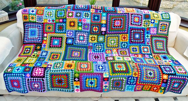 "Babette Meets Granny McPhee Blanket, crocheted by Maryfairy. 12 rd, 10 rd, 8 rd, 6 rd, 4 rd & 2 rd granny squares, JAYG. When making granny squares, always turn after each rd - the squares don't ""tilt"" & both sides of the blanket look the same. She's included a very helpful layout chart for the squares. . . . ღTrish W ~ https://www.pinterest.com/trishw/ . . . . #crochet #afghan #throw"