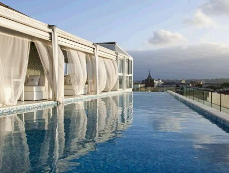 Roof top pool lounge at boscolo exedra hotel in rome - Hotel piscina roma ...