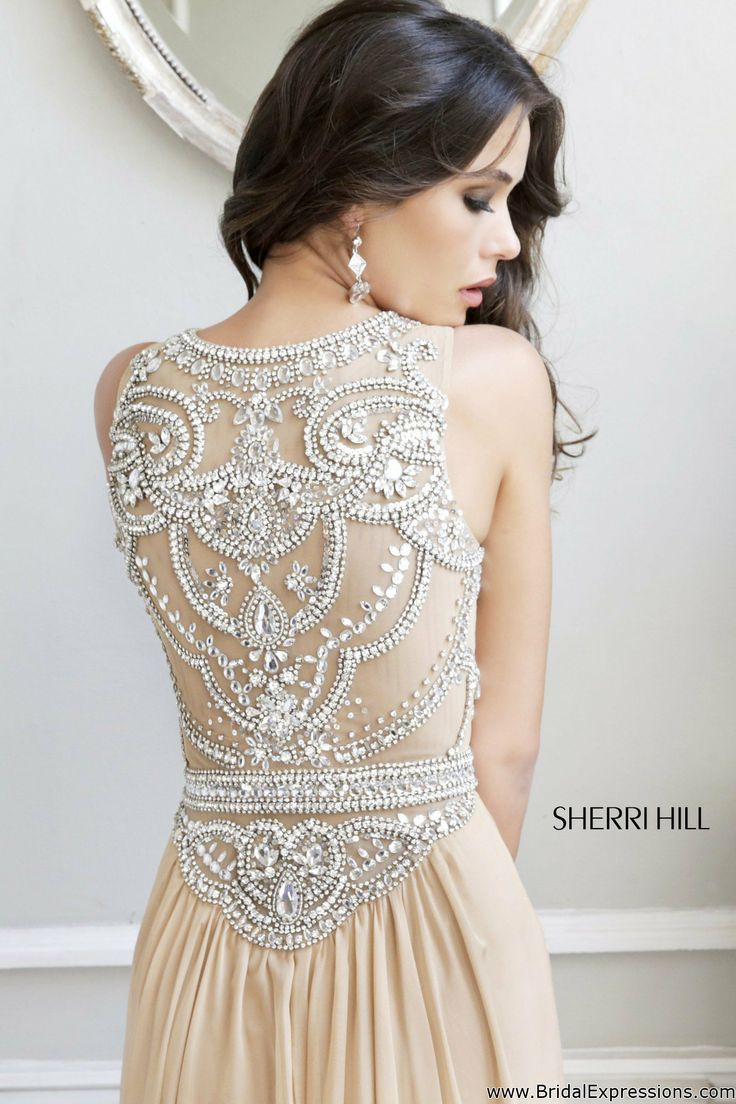 You will fall in love with this must have fitted dress by Sherri Hill