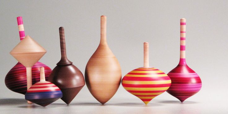 Wooden spinning tops                                                                                                                                                     More