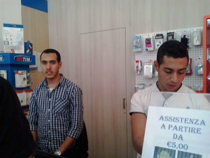 Arabian guys at work in their phone shop