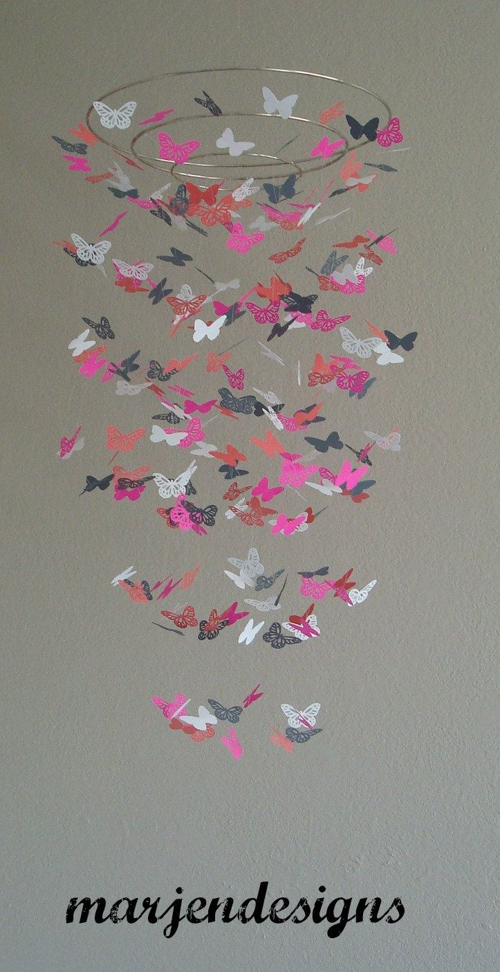 pink and coral nursery | Beautiful coral grey hot pink and white butterfly mobile nursery decor