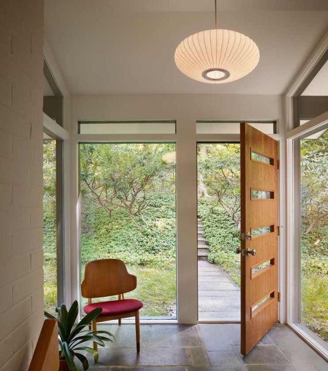 Modern foyer with a retro feel. Awesome front door.