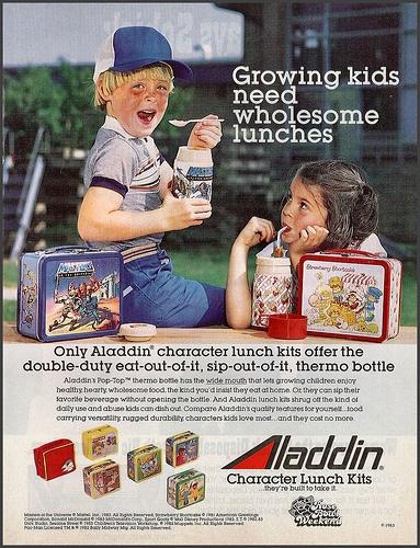 Aladdin Lunch Box ad, 1983; I had the Strawberry Shortcake lunch box on the right....