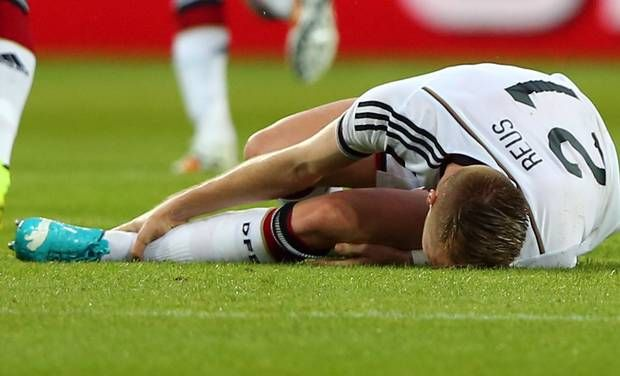 Germany suffer a blow after Marco Reus is ruled out of the 2014 World Cup, after sustaining a torn ankle ligament in a friendly against Armenia.