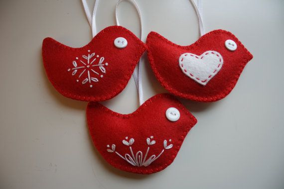* Set of 3 Charming little red birds for your Christmas Decorating!  * Hand sewn using wool blend felt  * Size - 4 W x 2 3/4 H  * Lightly filled with