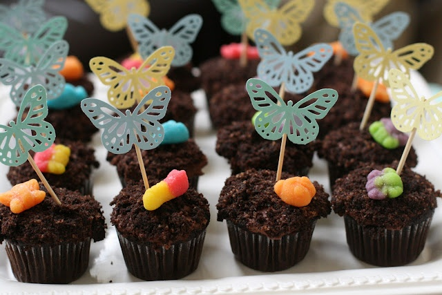 """Dirt Cupcakes! Devils food cake with fudge frosting, crumbled cake for the """"dirt"""" and topped with gummy bugs!"""