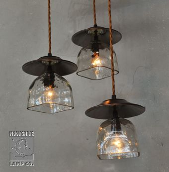 Who would have thought Patron bottles could take on a totally different feel when matched with these copper hats.  We love the far eastern feel of this 3-Light chandelier.