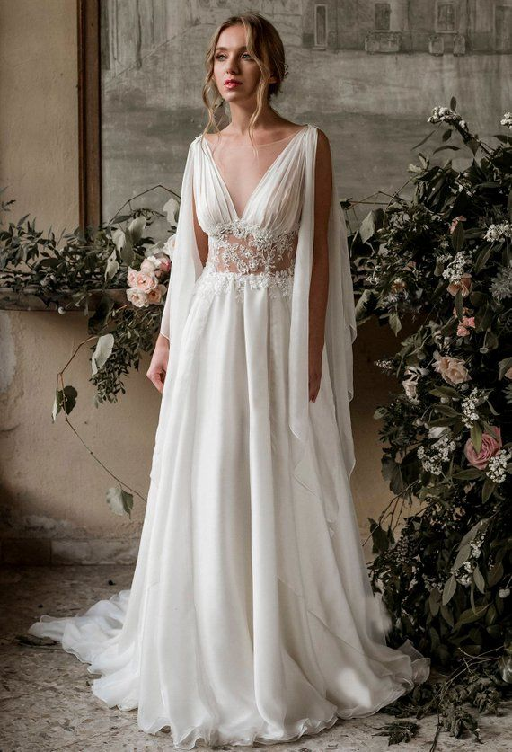 An ivory silk chiffon Grecian wedding gown, this design is perfect for the bride…
