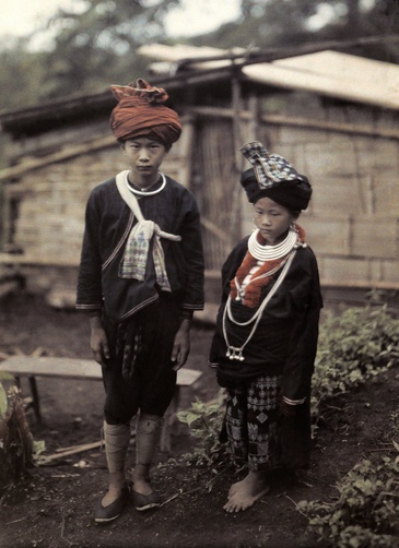 Autochrome: W. Robert Moore. Two children from the Yao tribe, pose in their embroidered clothes. Northern Siam.