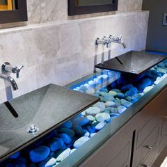 Bathroom vanity with glass and river rocks