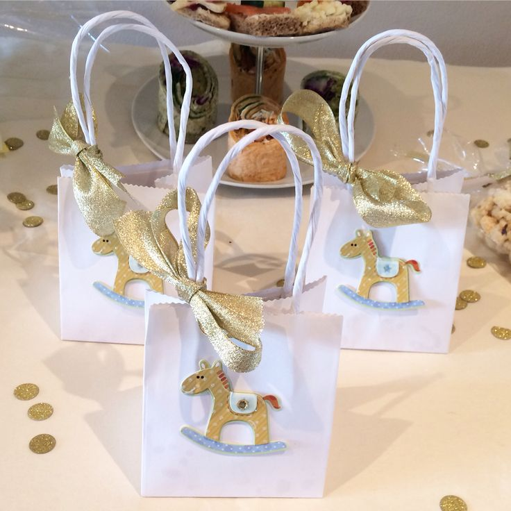 Homemade baby shower sweetie bags with gold ribbon and rocking horse https://www.facebook.com/Bonbonsbab/