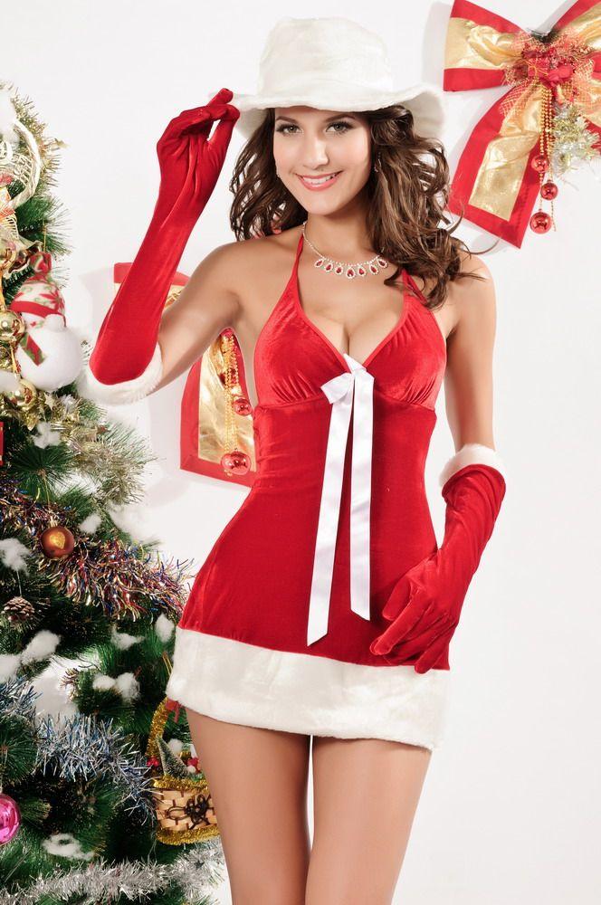 Kerstjurkje darling Santa  Artikelcode: 7192   De naam zegt het al (darling) schatje En schattig/sexy dat is deze jurk. Mooie halter kerstjurk met grote witte strik  aan de voorkant.   Mooi afgewerkt met brede nepbont rand aan onderkant van het jurkje. Het witte hoedje en de lange rode handschoentjes mogen ook niet ontbreken natuurlijk.  Dit kerstpakje, kerstjurkje heeft  de volgende maat:   One size S/L
