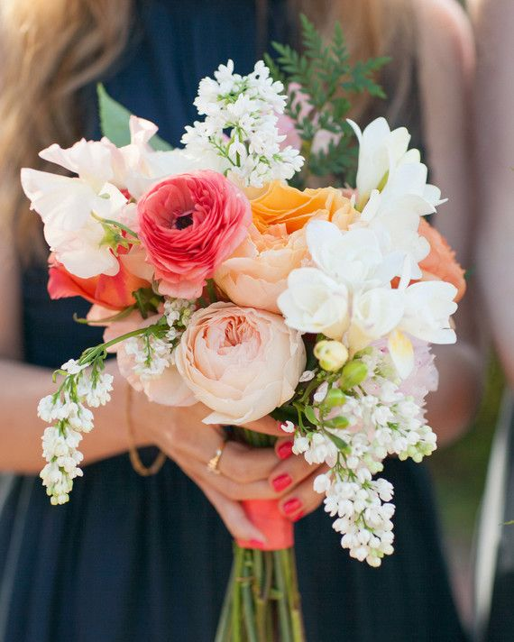 Twigg Botanicals created these vibrant bouquets of freesia, roses, and sweet peas that were held by the bridal party at this California wedding.