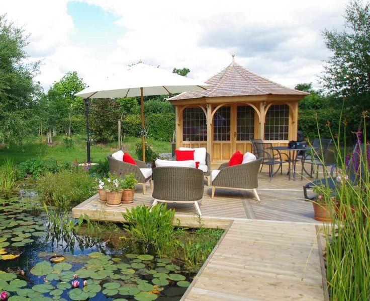 S45, 3.6m cedar summerhouse with bi-fold doors. Prices start around £9,980