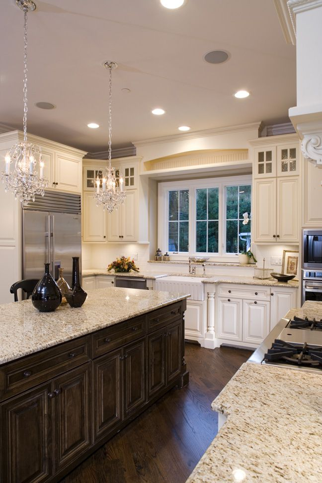 Kitchen with mix of dark wood and cream cabinets.