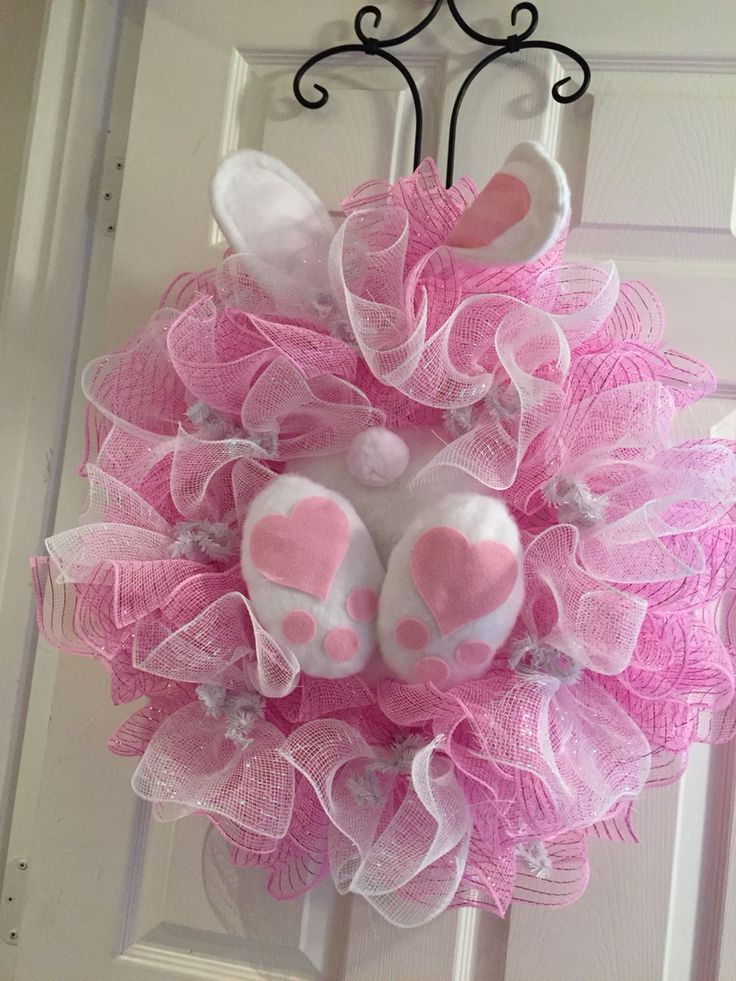 Easter 'cute as a bunny's booty' deco mesh wreath! This is with the ruffle technique, all pink on the outside ring and pink with white top on the inside ring. The bunny's feet and ears are the same color. Very cute and fun wreath! 3/2015