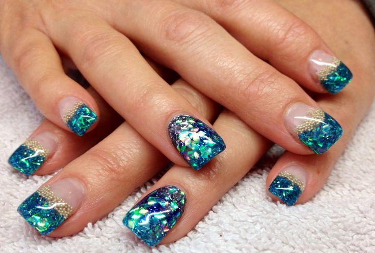 Aqua blue gel nails with blue glitters and diamond Mylar