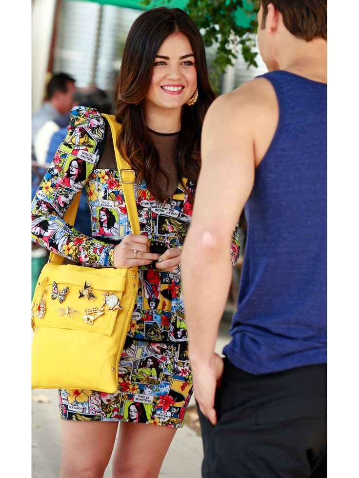 """Aria's style is definitely the most daring of the bunch—she's all about mixing prints, piling on fashion-y accessories, and trying statement silhouettes. Even though her style is definitely bold, Aria tends to stick to skirts, dresses, and heels, giving even the trendiest of looks, like this comic print dress a flirty feel. """"This comic book dress is my favorite,"""" Mandi Line, the costume designer behind all the looks on PLL, said. """"When Lucy was in fittings, she said, 'This is so obnoxious…"""