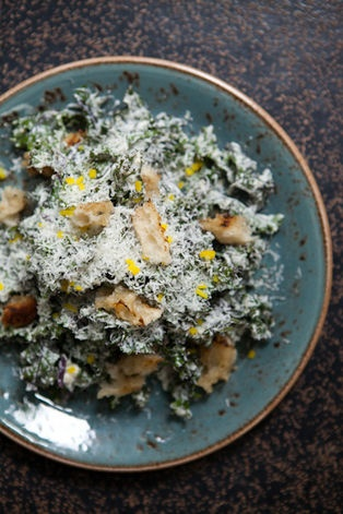 Shredded Kale Caesar, Parmiggiano Reggiano, Preserved Lemon, and Grilled Croutons