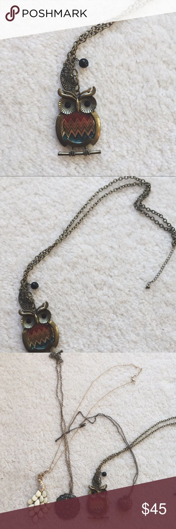 "Vintage multi-colored long owl necklace ⋈ Vintage long owl necklace with black bead eyes ⋈ Body of the owl is a colorful chevron print - chain is 16""/32"" total with a 2"" adjustable portion ⋈ Unknown gold metal, has experienced some discoloration and wear ⋈ Price is negotiable! Vintage Jewelry Necklaces"