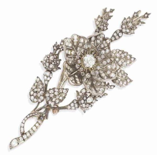 """Here's another gorgeous item belonging to """"a European princess"""": a classic diamond floral brooch, dated to the late nineteenth century. Lot #222 is """"designed as a floral spray, the central old-cut diamond flowerhead mounted en tremblant, raised above the similarly set diamond stem, to a diamond leaf and bud surround, mounted in silver and gold, circa 1880, 12.0cm, in original fitted case."""" It's a steal at an estimated 6,000 to 8,000 pounds, or $$7,716-$10,288 USD. Via thecourtjeweller"""