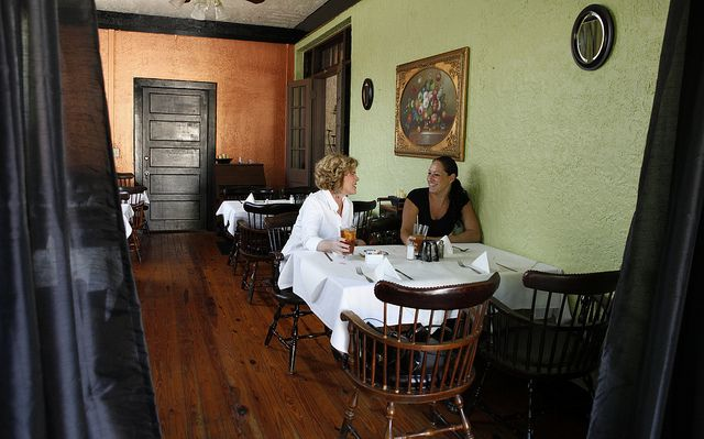 Diners eat at Sinatra's L'Aldila Restaurant located in the Cassadaga Hotel.The Cassadaga Hotel is a Spiritual Retreat and Haven for those seeking Higher Counsel and Spiritual Healing.