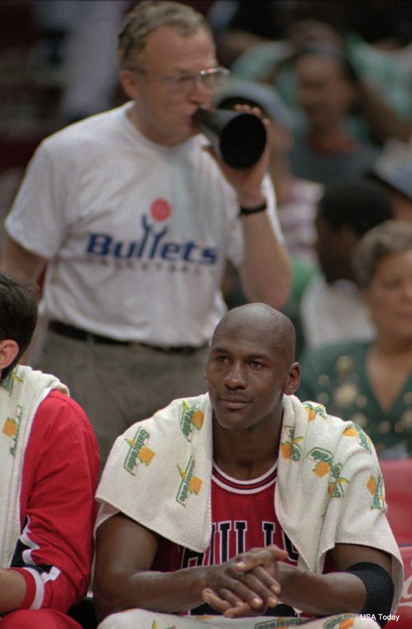 """At the request of Charles Barkley, Ficker even traveled to the 1993 NBA Finals in Phoenix, where he razzed Michael Jordan about a series of gambling allegations.   """"Barkley got me a seat behind the Bulls bench, so I brought these huge playing cards, dice and a bunch of dollar bills,"""" Ficker said. """"During the game, I'm dealing [Jordan] a hand and asking him what he wants to bet. And he's turning around and holding up three fingers. It was fun."""""""