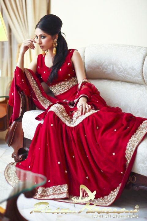 Indian bride wearing bridal lehenga and jewelry. #IndianBridalHairstyle #IndianBridalMakeup #IndianBridalFashion Designed by Rizwan Moazzam.