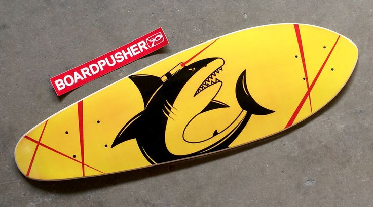 """For this week's BoardPusher Featured Deck we have a mini-cruiser designed by Geri Massengale. """"This 'Shark with Frickin' Laser Beams' skateboard is a gift to our Senior Talent Sourcing Manager. Our unofficial team mascot is the shark with laser beams and because he loves cruising we thought this would be perfect for him. I remade this using Illustrator, implementing Microsoft colors."""" Check out Geri's personal blog at www.craft-comfort.com. Design your own mini-cruiser at…"""