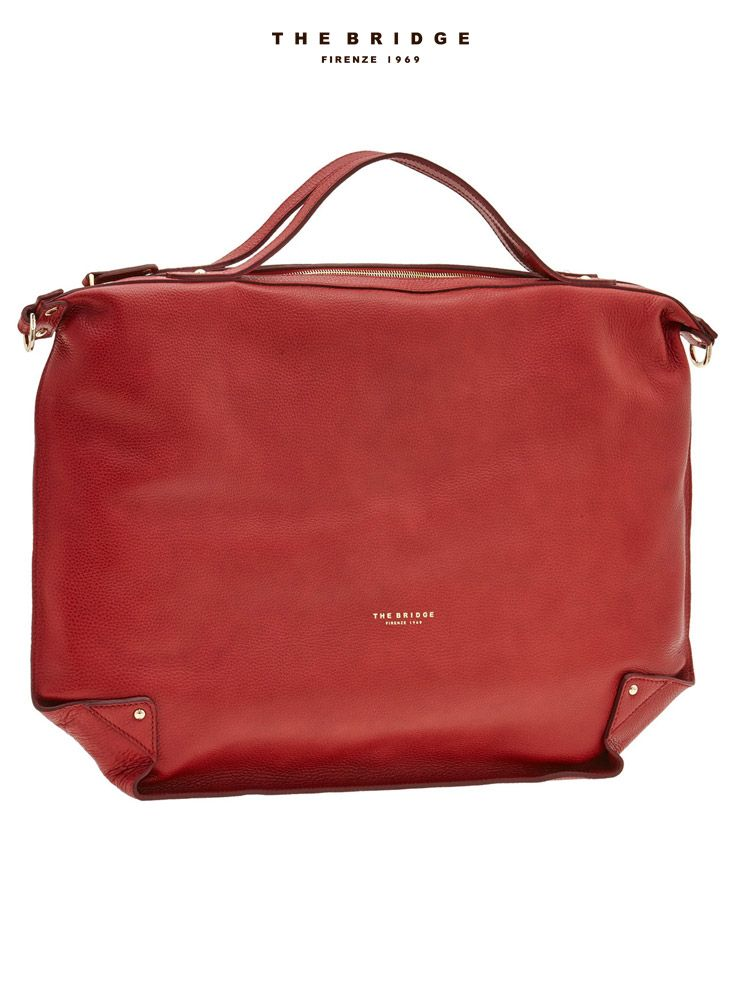 Gift idea for her: the Unica bag will add a touch of style to any outfit. Its ultra-flat, clean shape and bright, youthful shade of red make it a great statement piece.   #TheBridgeWoman #TheBridge