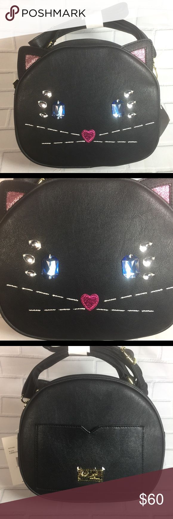 """NWT Betsey Johnson Purse This adorable NWT Betsey Johnson Kitty Jewel Face Mini Crossbody is faux leather and has sparkling jewel accents. This is the larger version, NOT the mini. There's an adjustable crossbody strap, zippered top closure and an exterior slip pocket. The interior features one zippered pocket, two slip/cellphone pockets, and is lined with striped fabric. It measures 9"""" x 8"""" x 4"""". (I don't want to """"unwrap"""" the bindings; therefore, I'm adding a few stock pictures for better…"""