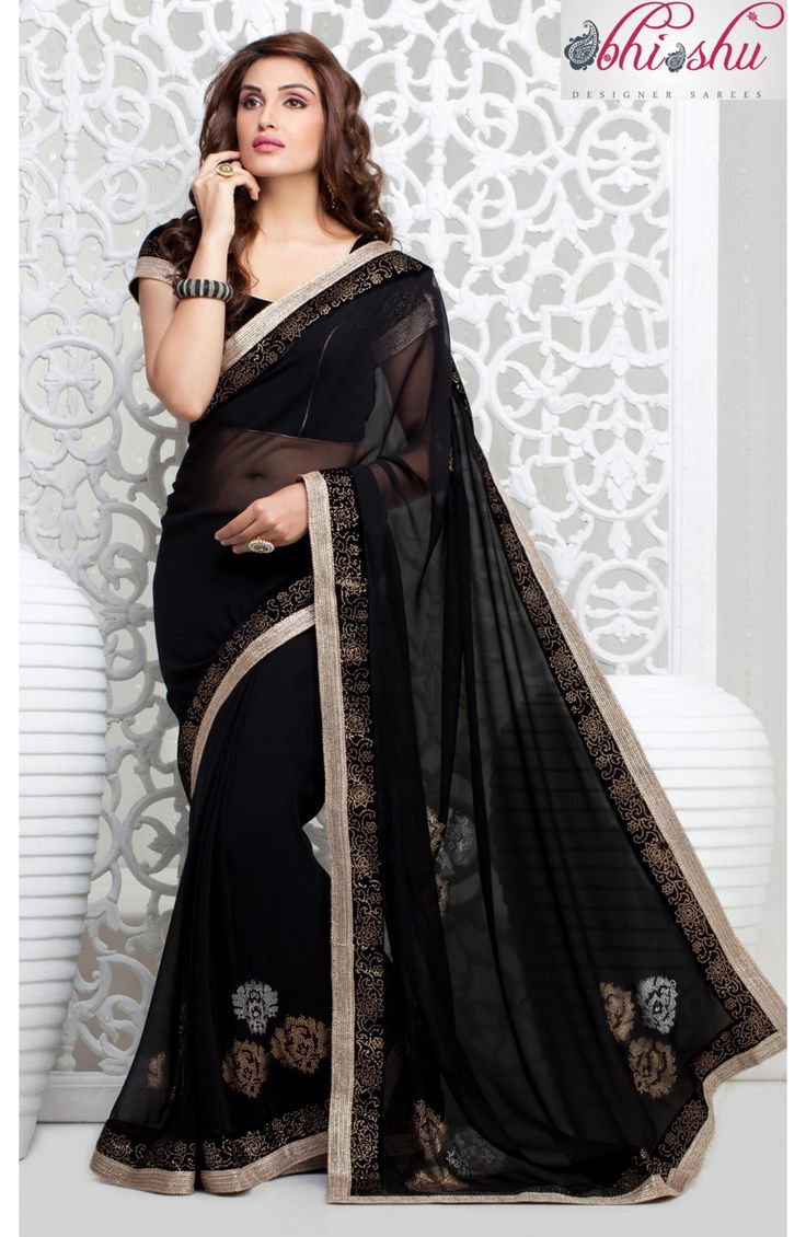 Add charm to your looks in this attractive black georgette saree.The saree is beautified with stick on crystals pattern. Contrast zari patch border makes you look extraordinarily beautiful. #Sarees #saree #ladies-fashion #India-fashion #onlineshopping #buysareeonline #bananafashions