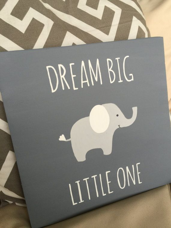 Hang this hand painted sign in your little ones nursery! It also makes a great baby shower gift. This listing includes one handmade sign. This sign measures approximately 12 x 12. It is hand painted grey with the words Dream Big Little One painted in white. It also has a white and grey elephant. You have the option to purchase the sign only or I can add a sawtooth hanger on the back for easy mounting. Looking for a gender specific sign? Include a note in the message and I can customize…