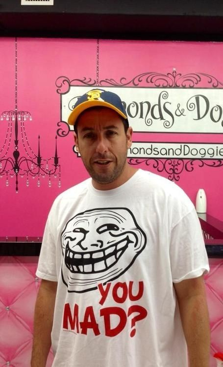 Okay, here it is, here is a photo of famous comedian Adam Sandler wearing a rage comic shirt.