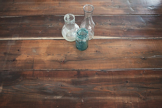DIY wood stain.  I did a little research on how to re-create weathered wood. The answer: soaking steel wool in vinegar. I found that 24-36 hours of soaking gave me the color I liked. Soak it for a few days and the steel wool rusts, giving you a redder color.