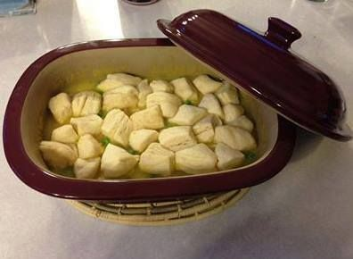 Chicken and Dumplings PULL OUT YOUR DEEP COVERED BAKER place 3-4 (defrosted) raw chicken breasts in baker - about 1 lb. pour 2 cans of cream of chicken soup, and 1 cup of chicken broth over chicken. cover and microwave on high for 10 minutes stir, cover again and microwave additional 10 minutes shred chicken, stir in 1/2 cup frozen peas,carrots, string beans. cut 1 small can of refrigerated biscuits into pieces . Dump biscuit pieces on top of chicken,cover and microwave on high for 5 minutes